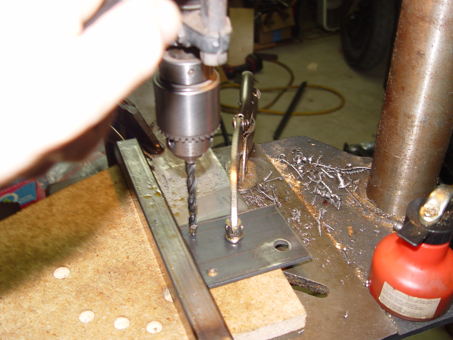 Photo of drilling holes in shock mounting bracket