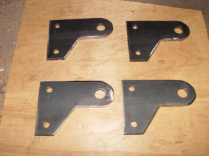 Four shock mounting brackets