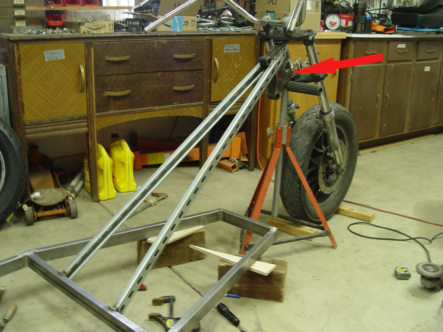 Photo of front fork being welded to chopper trike
