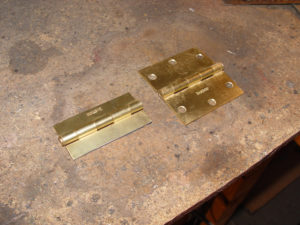 Photo of cut down steel door hinges