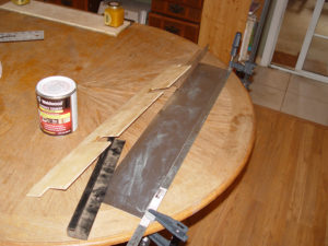 Photo of aluminum flashing being glues to plywood panel core