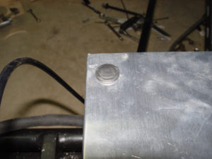 Close up photo of installed body panel rivet