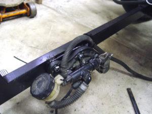 Voyager brake pedal assembly mounted to trike frame