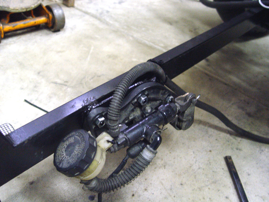 Voyager brake pedal assembly mounted to trike frame