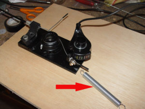 Photo of thumb throttle return spring used