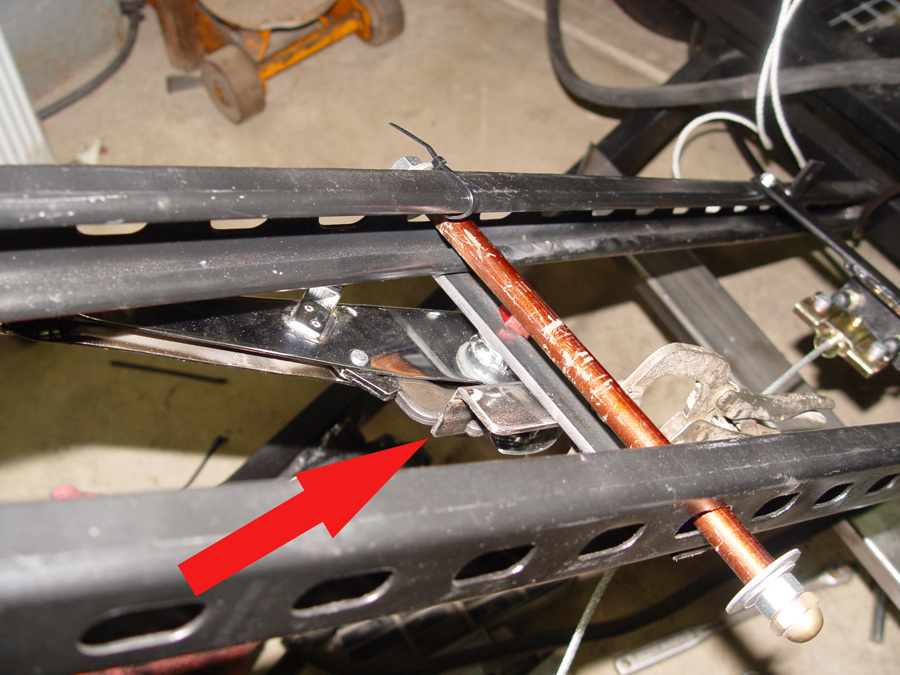 Mounted emergency brake lever showing ratchet stop
