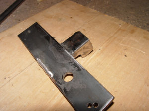 Photo of ratchet stop welded to mounting bar