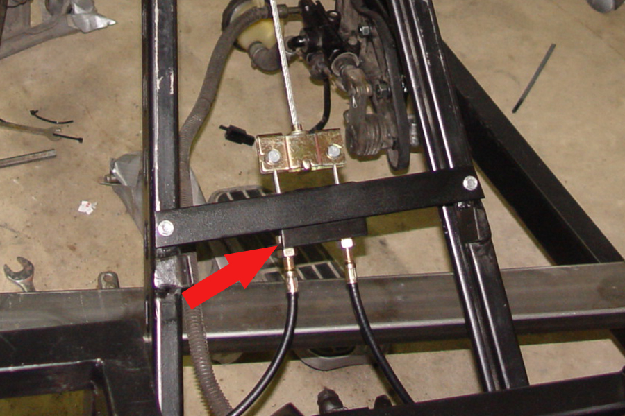 Photo of emergency brake cables bolted into bracket